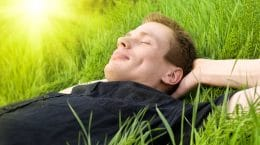 man laying in grass