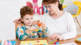 occupational therapist and little boy