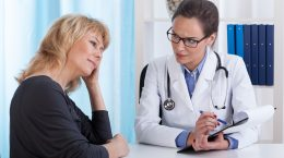 woman doctor consulting patient